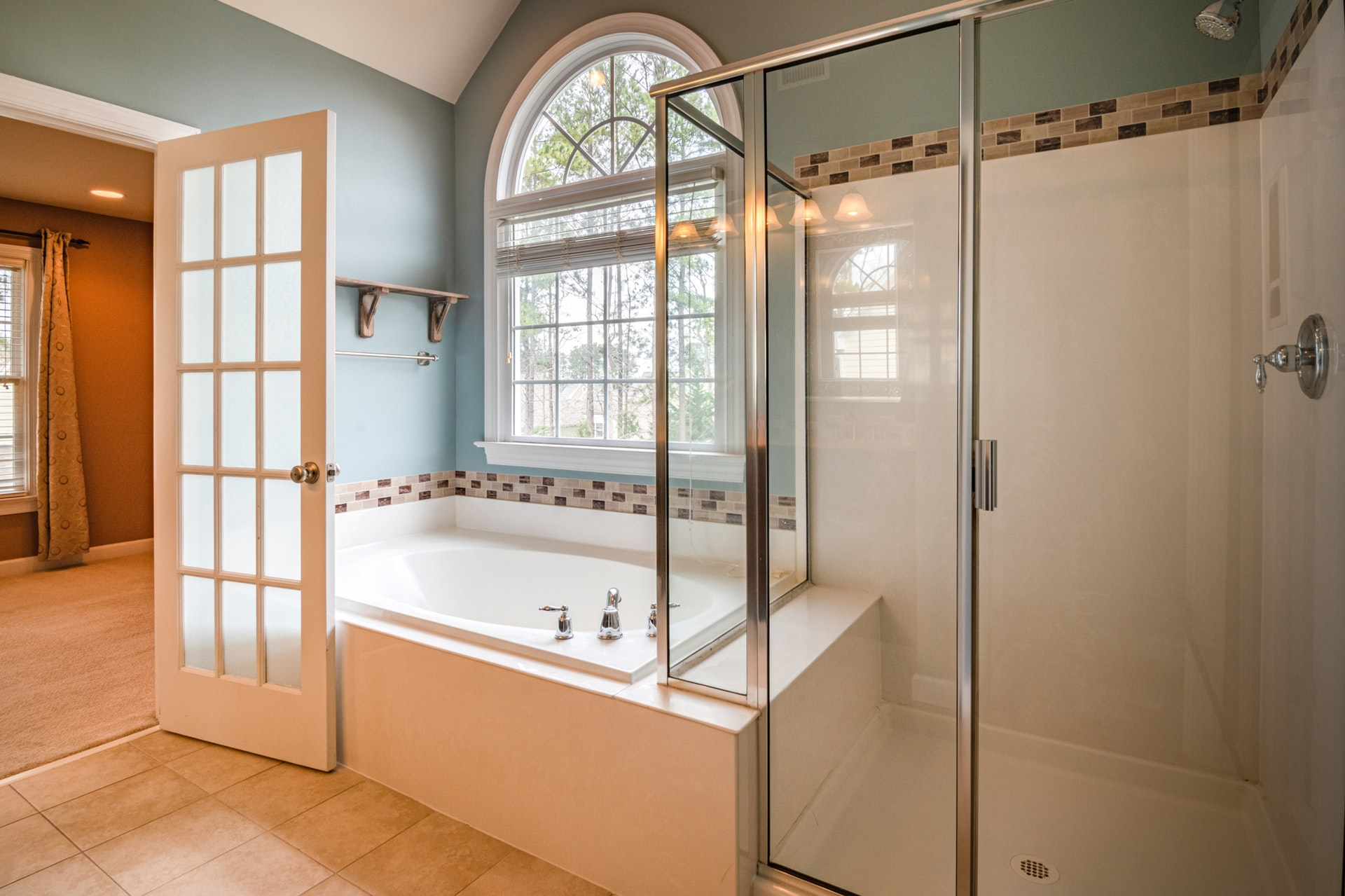 How Do I Save Money on Bathroom Shower Doors?
